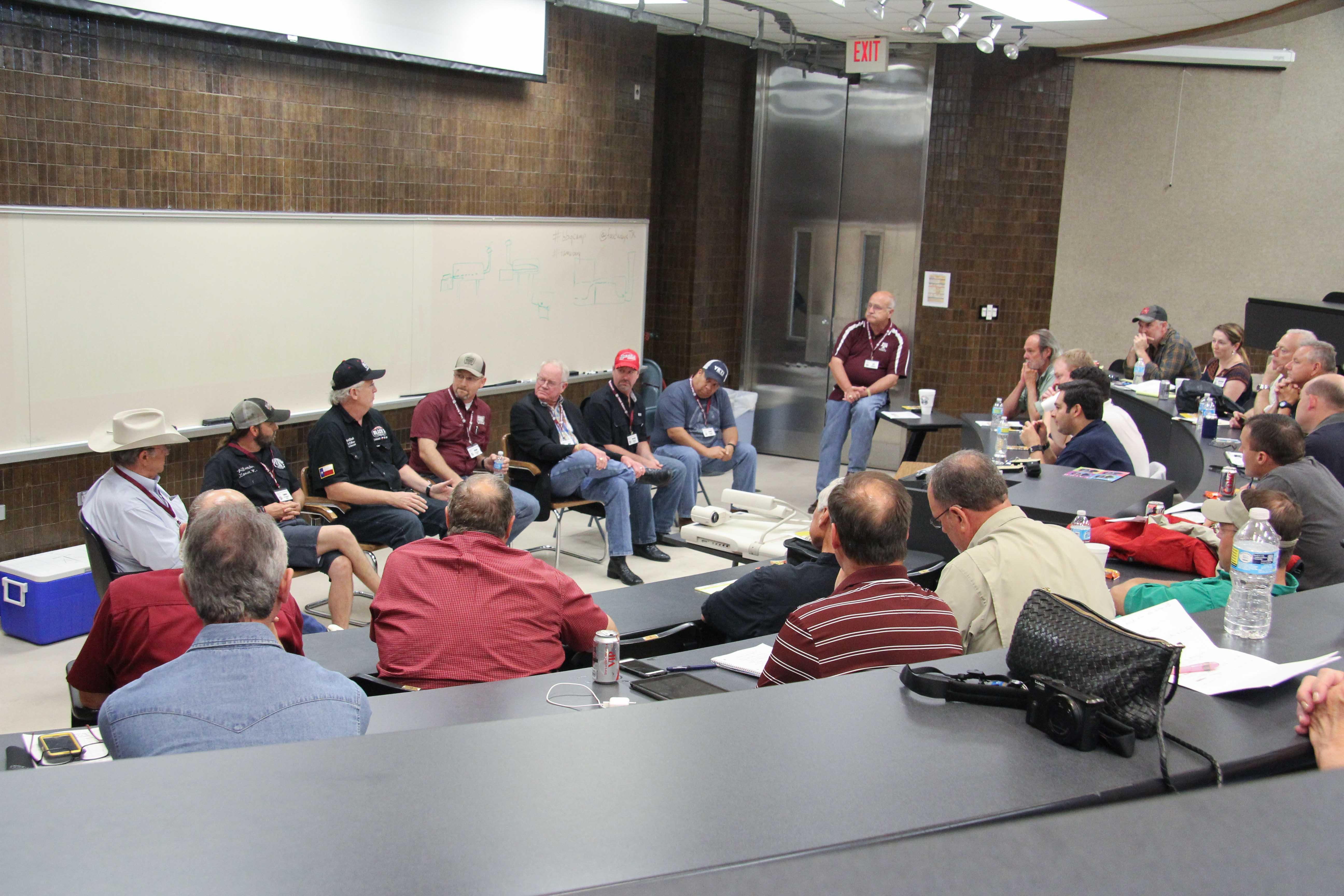 L-R: Tom Perini, Lance Kirkpatrick, Kent Black, Bryan Bracewell, Nick Nickelson, Russell Roegels and Israel Campos talking wood & smoke