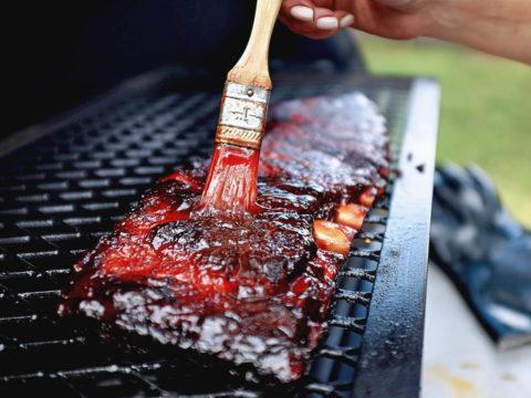 big red rib glaze on ribs with brush