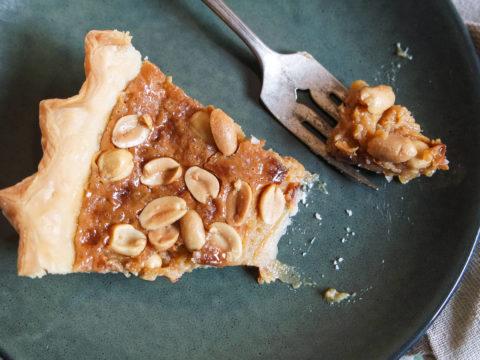 slice of peanut brittle pie on amfora plate