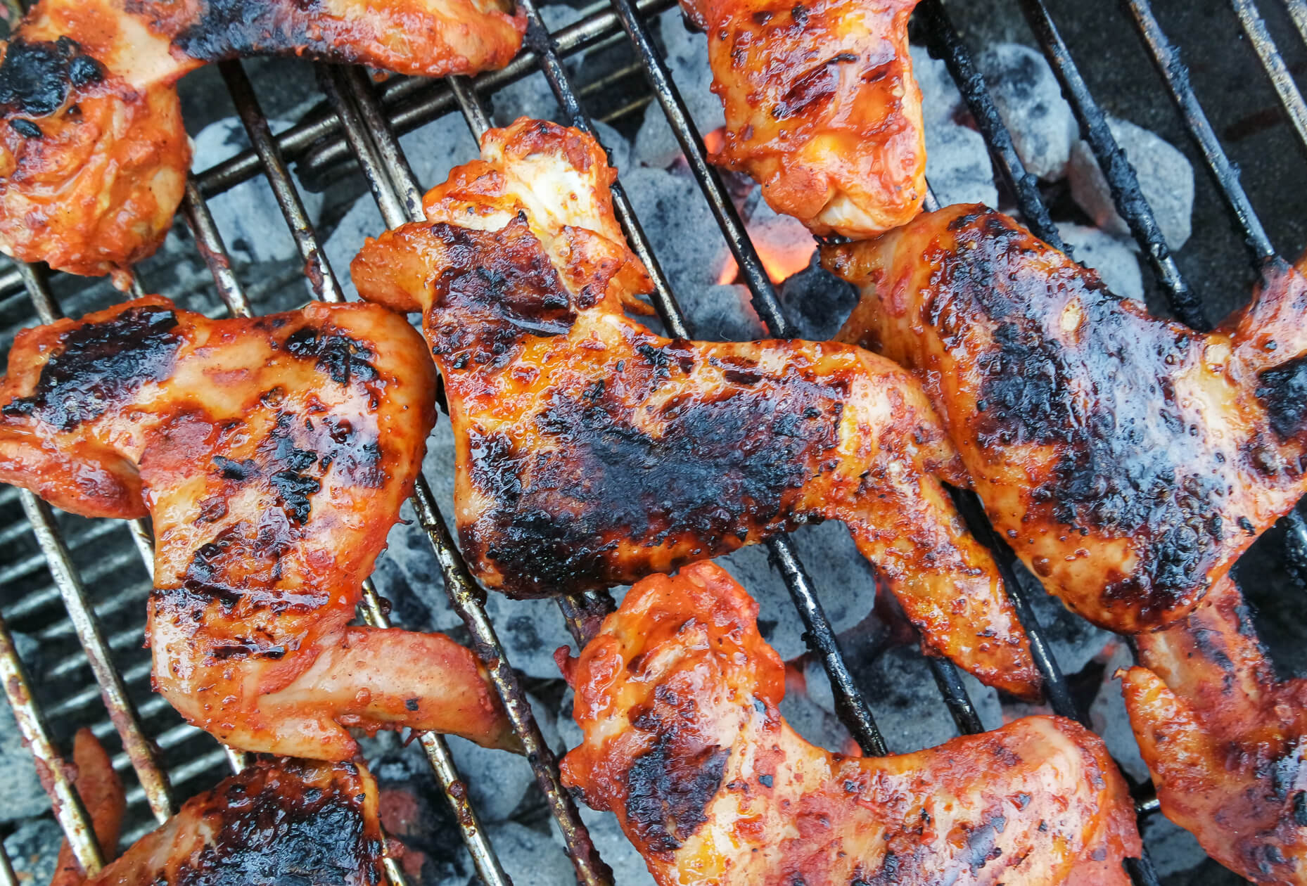 achiote pibil wings being grilled