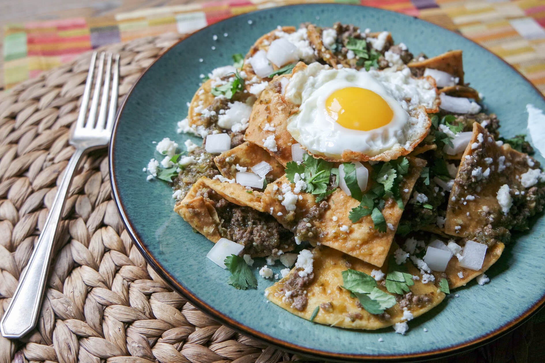 finished chilaquiles verdes with fried egg