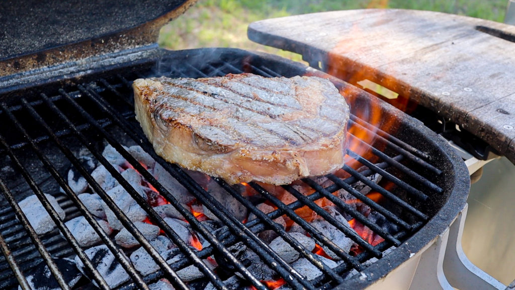 searing a steak on a grill