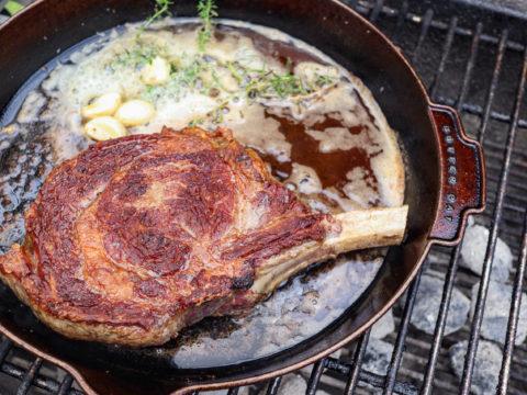 butter basted ribeye steak in butterpat skillet